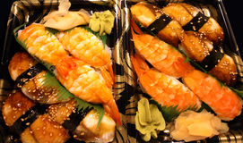 Shrimp and Eel. Grouping of Japanese sushi including shrimp and eel on serving plates stock photos