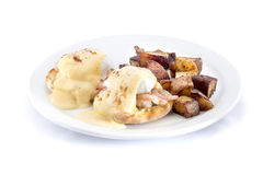 shrimp eggs benedict with hash browns Stock Photo