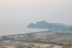 Shrimp farms and limestone mountains Royalty Free Stock Photography