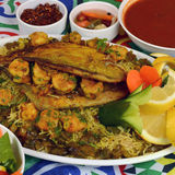 Shrimp and fish Kabsa. Mixed rice dishes that originates in Yemen. Middle  eastern food Stock Photography
