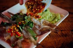 Shrimp in fish sauce at Thai seafood market. Shrimp in fish sauce premium grade is a seafood display for sale at Thai street food market or restaurant in Bangkok royalty free stock photo