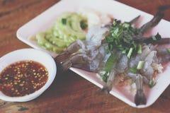 Shrimp in fish sauce at Thai seafood market. Shrimp in fish sauce premium grade is a seafood display for sale at Thai street food market or restaurant in Bangkok royalty free stock image