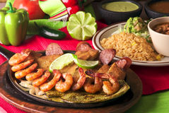 Shrimp, fish and sausage hot plate Stock Image