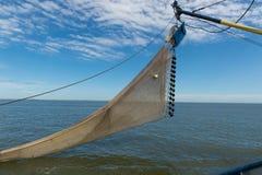 Shrimp fishing net detail on dutch fishing boat. Shrimp fishing boat ready to drop the net into the water of the sea Stock Photo