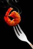 Shrimp on a fork Royalty Free Stock Image