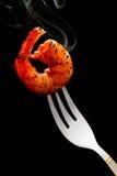 Shrimp on a fork Royalty Free Stock Image