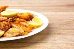 Fried shrimps with lemon. Royalty Free Stock Image