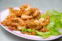 Shrimp fried with garlic. On dish Stock Images
