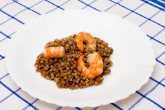 Shrimp fried in oil laid out on white plate buckwheat Stock Photos