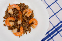 Shrimp fried in oil laid out on white plate buckwheat Royalty Free Stock Photo