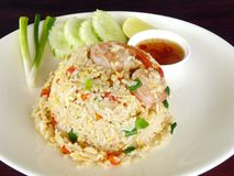 Shrimp fried rice with cucumber. Delicious Thai Asian food. Shrimp fried rice with cucumber, onion and Thai& x27;s fish spicy sauce in a clean white plate on Royalty Free Stock Photography