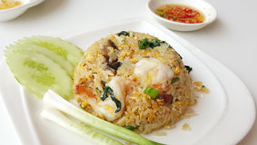 Shrimp fried rice serving with onion and cucumber slice Stock Images