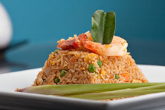 Shrimp Fried Rice Thai Dish. A Thai dish of shrimp fried rice presented on a square white plate in the shape of a pyramid Royalty Free Stock Photo