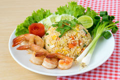 Shrimp fried rice. On wooden background Stock Photography