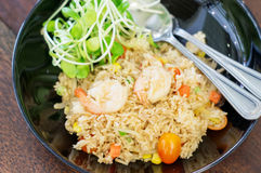 Shrimp fried rice. With young sunflower sprouts Stock Image