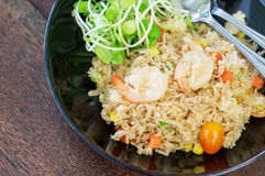 Shrimp fried rice. With young sunflower sprouts Royalty Free Stock Photos