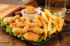 Shrimp, fries and beer Stock Image