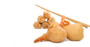 Shrimp fritter. And spring roll with chopsticks royalty free stock image