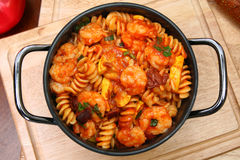 Shrimp and Fusilli Pasta. In Metal Pot in kitchen or restaurant royalty free stock photography