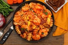 Shrimp Fusilli Pasta with Veggies. Shrimp Fusilli Pasta with Carrots, Green Beans, Cranberry Juice and Barley Apricot Crisp at table royalty free stock photos