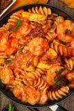 Shrimp Fusilli Pasta with Veggies. Shrimp Fusilli Pasta with Summer Squash at table royalty free stock images