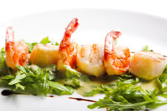 Shrimp with greens Stock Photos