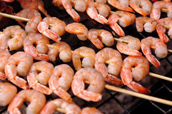 Shrimp grill. Seafood grilled on wooden skewers Royalty Free Stock Image