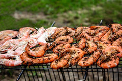 Shrimp on the grill. Delicious grilled shrimps on the BBQ Grill stock photography