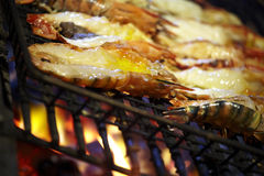 Shrimp grill on fire Stock Image