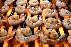 Shrimp On A Grill Over Open Flames Royalty Free Stock Photos