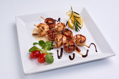 Shrimp from the grill. Tomatoes. Lemon. Greens. Royalty Free Stock Photography