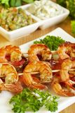 Shrimp-grill on wooden sticks Stock Photo