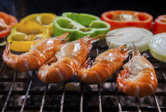 Shrimp grilled on barbecue stove with chilly and onion ring Royalty Free Stock Photo