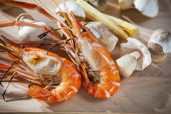 Shrimp grilled with corn and mushroom on clean wood plate Royalty Free Stock Photography