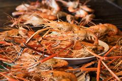Shrimp grilled in grilling basket. Grilled shrimps on the flaming grill, seafood stock images