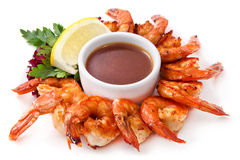 Shrimp grilled with sauce and herbs. Fried Shrimps with lemon sauce and herbs.  on White Background Royalty Free Stock Images