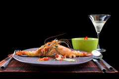 Shrimp grilled and spicy sauce on black background Stock Photography