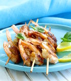 Shrimp grilled on wooden skewers with lemon Royalty Free Stock Images