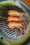 Shrimp grilling stock images