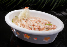 Shrimp with herbs. Boiled shrimp served in a white bowl royalty free stock image