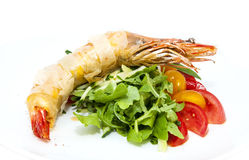 Shrimp. Jumbo shrimp with herbs and several types of tomatoes Royalty Free Stock Image