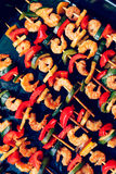 Shrimp kebabs on black baking, diagonally Stock Photography