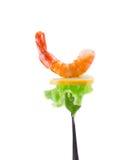Shrimp and lemon on a fork. Stock Photo