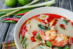 Shrimp and lemon grass spicy soup with mushrooms, famous Thai food cuisine calling Tom Yum Kung Royalty Free Stock Photo