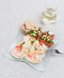 Shrimp Linguine. An angled top view of a glass plate of garlic shrimp linguine with a mandarin and garlic sauce with a side of a tomatoes,cucumbers and parlsey Royalty Free Stock Photos