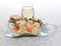 Shrimp Linguine 4. An angled front portrait view of a glass plate of garlic shrimp linguine with a mandarin and garlic sauce with a side of a tomatoes,cucumbers Royalty Free Stock Photo