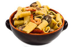 Shrimp and Mushroom Pasta in ceramic clay pot Royalty Free Stock Images