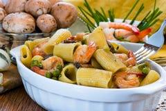 Shrimp and Mushroom Pasta in ceramic clay pot Royalty Free Stock Image