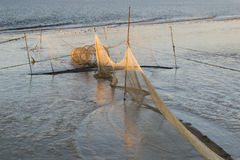 Shrimp nets in Wadden Sea at low tide at sunset royalty free stock images