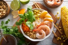 Shrimp Noodle Bowl. A delicious shrimp noodle bowl with rice noodle, mandarin orange, grilled corn, peanuts, shredded carrot, cilantro and toasted sesame stock photos